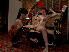 Redhead Iona Grace gets toyed with a strap-on by Gia Dimarco