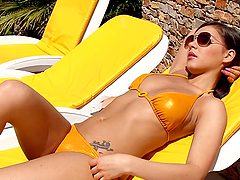 Sizzling Henessy takes sunbathes and masturbates by the pool