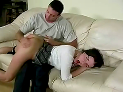 Brunette girl in a miniskirt gets her ass spanked hard