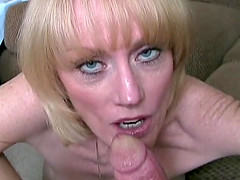 Busty mature blonde sucks on a guy's hard cock in POV