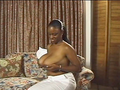 Huge-breasted ebony milf enjoys toying her shaved pussy