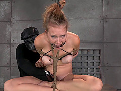 Busty slaved damsel in bondage yelling while being tortured in BDSM seen