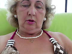 Horny mature granny fingering pussy then licking toys