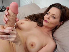 Mature MILF Gemma Gold strips and masturbates in stockings