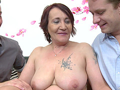 Two young guys talked mature Paulina K into pleasing them together