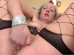 Blonde bitch fucks her mature horny cunt with dildo