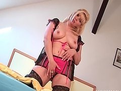 Seductive mature blonde teasing her cunt and tits