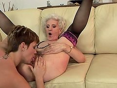 Nasty granny gets her hairy pussy licked by some pervert chick