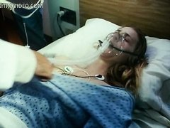 Gorgeous Blonde Babe Kathleen Kinmont Laying Topless On a Hospital Bed