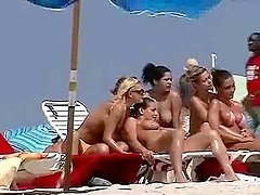 Nude beach hotties get filmed with a hidden cam while having rest