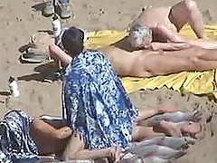 Kinky couple doesn't feel shy while making love on a nude beach