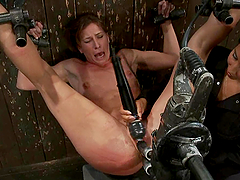 Ariel X gets double penetrated by a fucking machine in a cellar