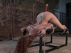 Sabrina Fox enjoys having a burning candle in her ass in BDSM scene