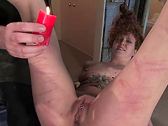 Curly girl gets whipped and fucked in bondage video