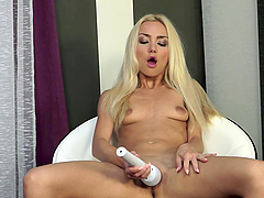 Long-Haired Blonde Fingering and Toying Her Snatch for Orgasm