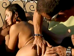 Lustful brunette chick gets fucked in both holes