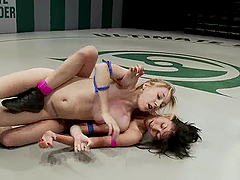 Blonde girl gets toyed by two brunettes in a ring