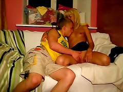 Blonde teen blows her boyfriend before riding him on a couch