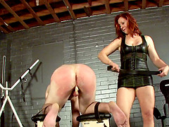 A brunette lady playing a dirty game with a fetish lover
