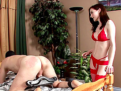Stunning dominatrix with big beautiful tits spanking a stranger