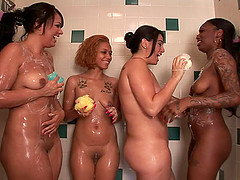 Chubby lesbian with big boobs enjoying a shower with three other girls