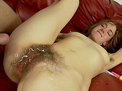 Lingerie-clad brunette with a slim body getting her hairy pussy licked