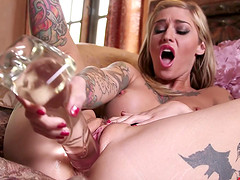 Tattooed pornstar passionately fingers her pussy then later drills it with huge toys