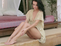 Babe in a sexy dress makes an erotic masturbation video
