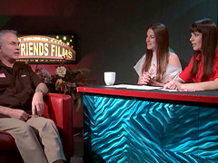 Pornstars host a talk show with a producer on as their guest