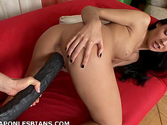 Skinny lesbian has her coochie widened with a monster strap on dildo