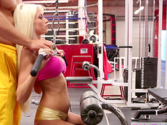 Tempting blonde with a shaved pussy rides cock in the gym