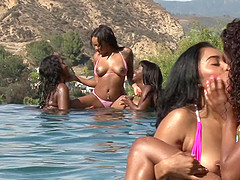 Black girls in bikinis have a hot lesbian orgy in the pool