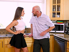 Miniskirt hottie sucks dick and gets ass fucked in the kitchen