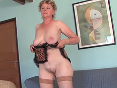 Old whore in leopard print lingerie fucks a long dildo