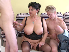 Dark-haired housewife with huge hooters and her two horny apprentices