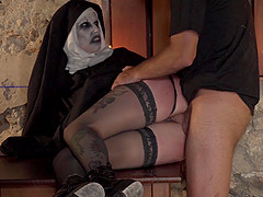 Horny nun with lots of makeup is ready for some cock riding