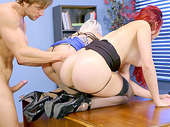 Sweet redhead shares the cock with a blonde in the office