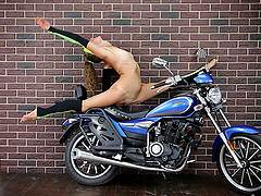 Flexible Russian chick exposes her private areas by the bike