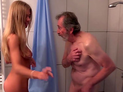 Gorgeous blonde sucking and fucking old cock in shower