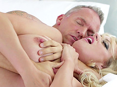 Glamorous blonde filly taking the hard mature dick into her depths