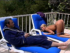 Missionary pounding for a blonde babe near the pool