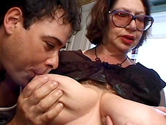 Judy is a mature chick with big tits enjoying two big cocks