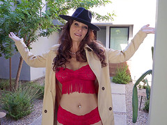 Syren De Mer is a dolled up cougar ready to attack a fellow