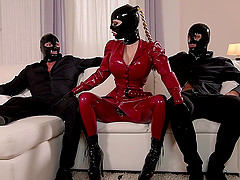 Lucy Latex likes to moan while two guys fuck her delicious pussy