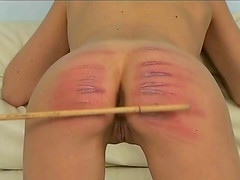 Slim chick bends over the couch to get her firm ass punished
