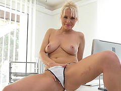 Naughty blonde secretary Kathy Anderson strips in the office