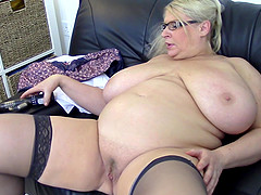 Mature busty blonde BBW Sammy Sanders strips and masturbates