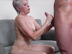 Short haired blonde granny Lady Sextacy strokes a cock with her feet