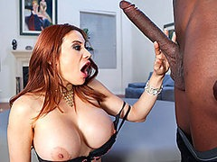 Voluptuous Redhead Babe Sucks and Fucks A Monster Cock