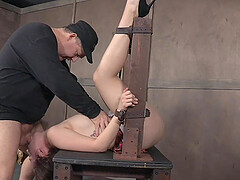 Teen in a miniskirt Nora Riley cries in an abusive bondage scene